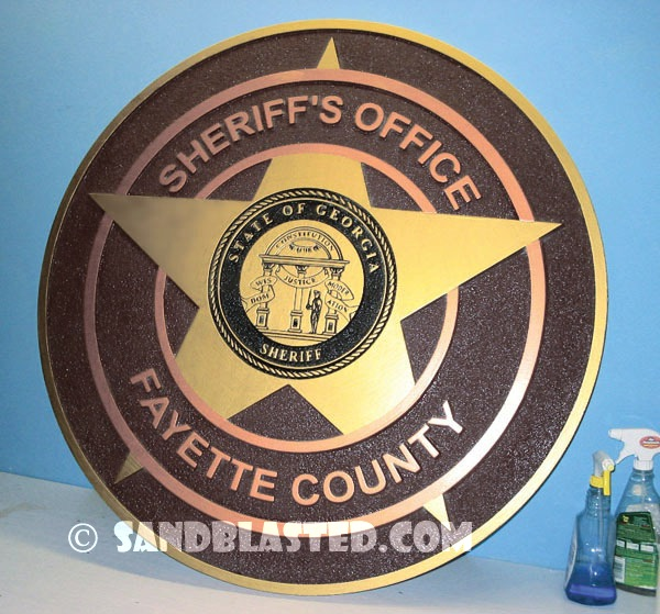 This Sheriff's Office plaque was sandblasted with the ...